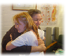 patient hugging her chiropractor, Dr. Aine Sweeney